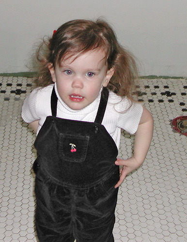 Chloe on the tile floor
