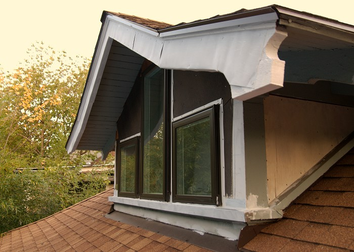 The lazy (but fast) way out of the mess of a back dormer...covering it with metal!